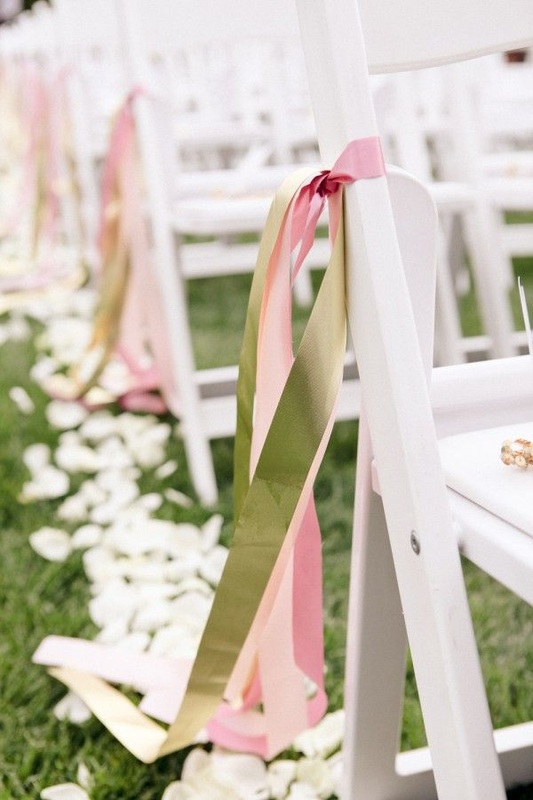 streamers on wedding aisle chairs