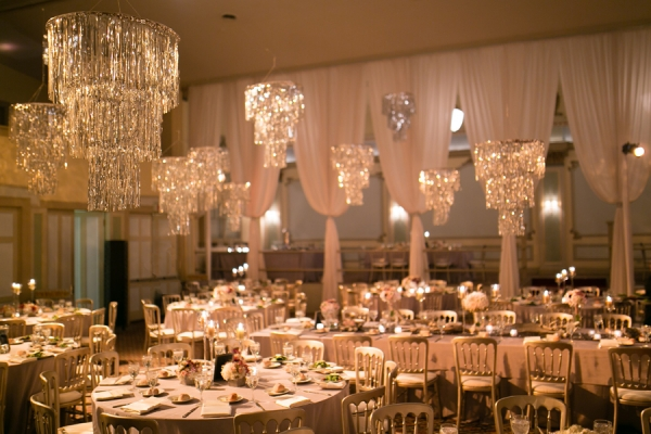 sparkling wedding chandeliers and reception tables
