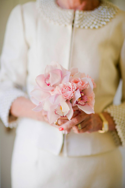 mother of the bride holding bouquet