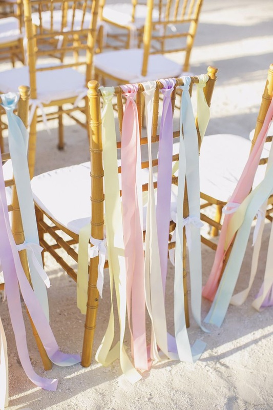 streamers on wedding reception chairs