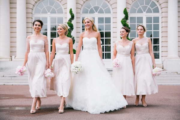 bride with bridemaids in white dresses outside french chateau