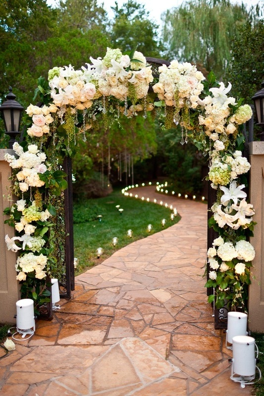 Wedding flower archway with lighted pathway