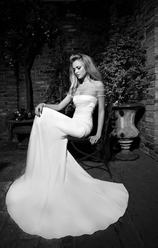 wedding dress ivory silk mermaid dress with flesh colored detail on top, dress and sleeves decorated with rows of pearls