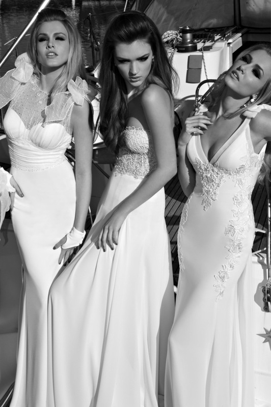 wedding dresses - Silk crepe and dotted tulle dress, pearl and crystal embellishments, with floral bows over shoulders. Chiffon and satin dress, transparent details, ornate with antique medallions, bows, and train. Sheer corset and pleated chiffon skirt, with satin bows all along back