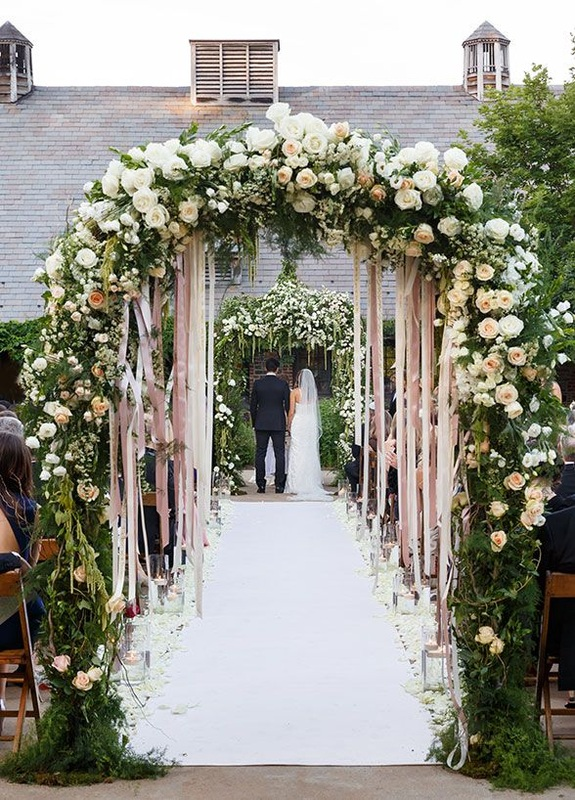 Steamers under wedding flower arbor