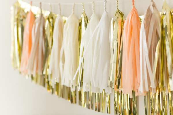 hanging gold and white pom poms