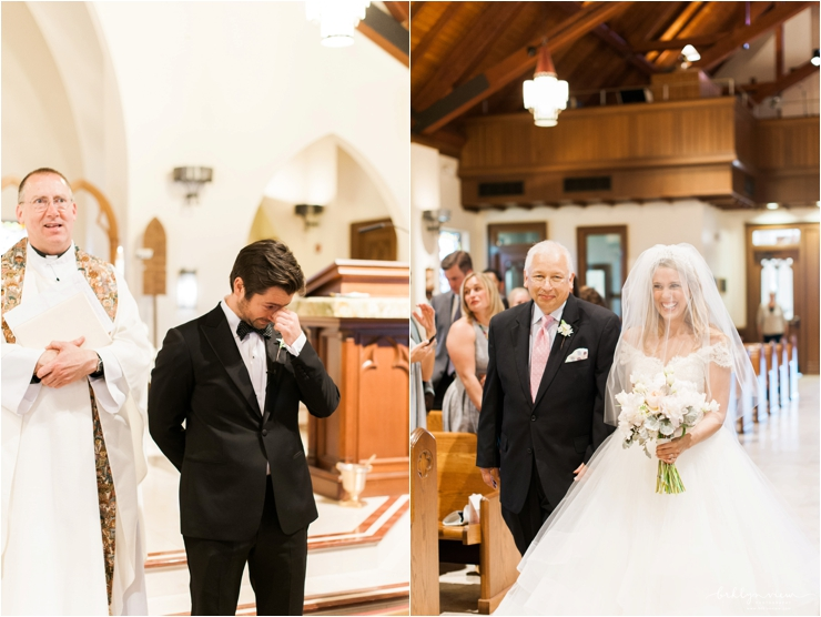 bride walking down the aisle with father and groom choking up