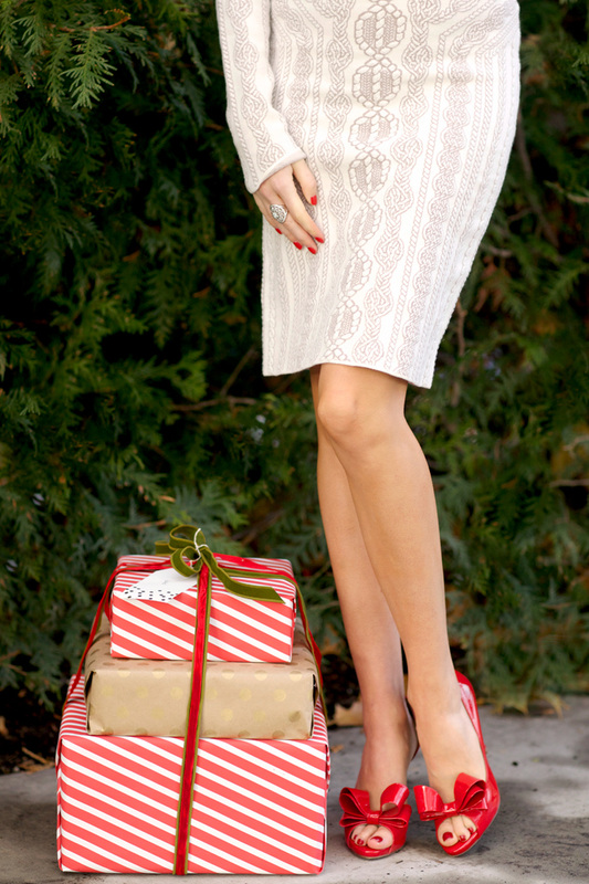 Pink Peonies, red Valentino heals next to wrapped Christmas presents