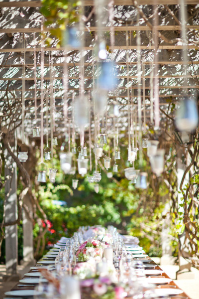 hanging candles and rustic wedding table setting