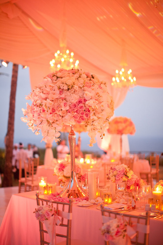 pink wedding up-lighting, candles and chandeliers