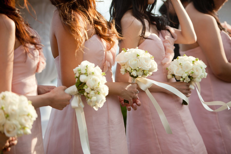 bridesmaids in pink dresses and white flowers