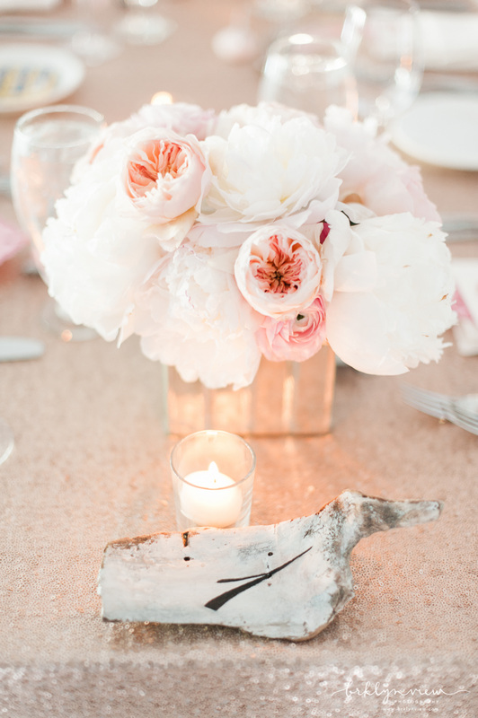 sequin wedding linens, white reception chairs and peach peonies