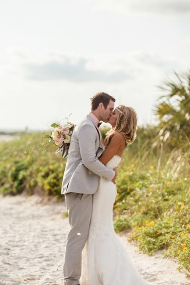 bride and groom on beach pathway