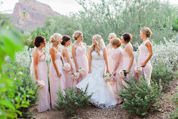 bride with bridesmaids in desert scenery