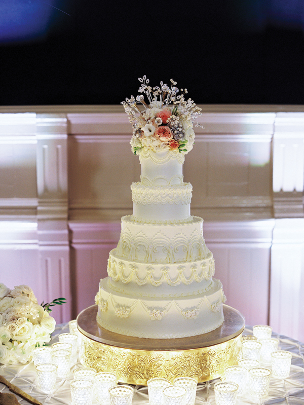 five tier wedding cake with flowers on top