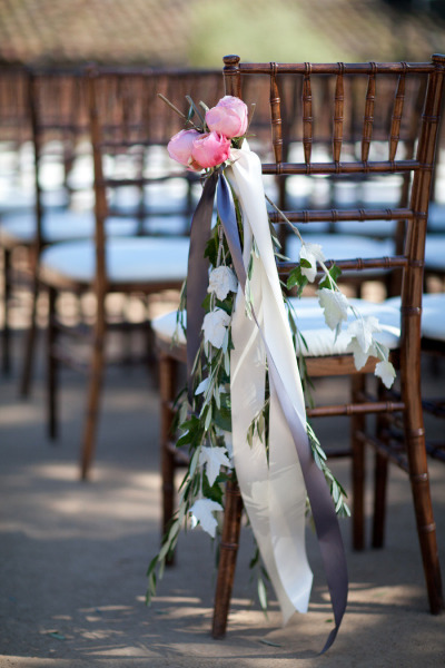 chiavari chairs with hand tied flowers