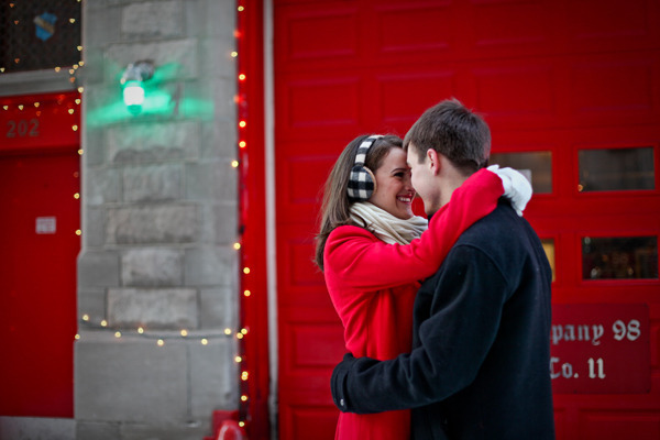 couple kissing in front of fire station at night