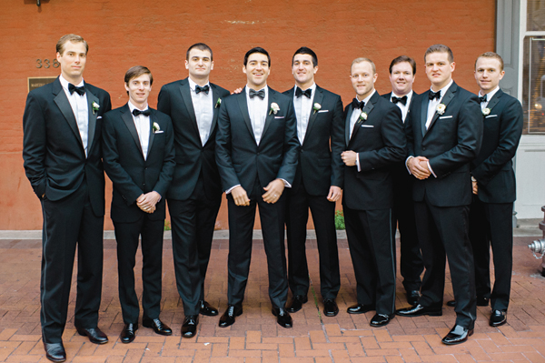 groomsmen in black tuxes