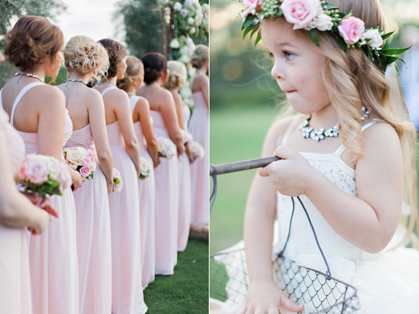 pink bridesmaid dresses and adorable flower girl with flower halo