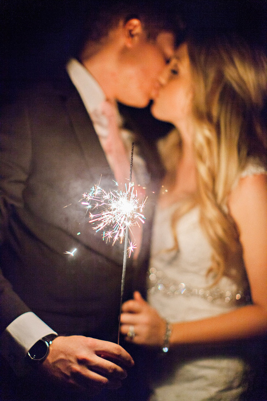 sparkler with bride and groom kissing