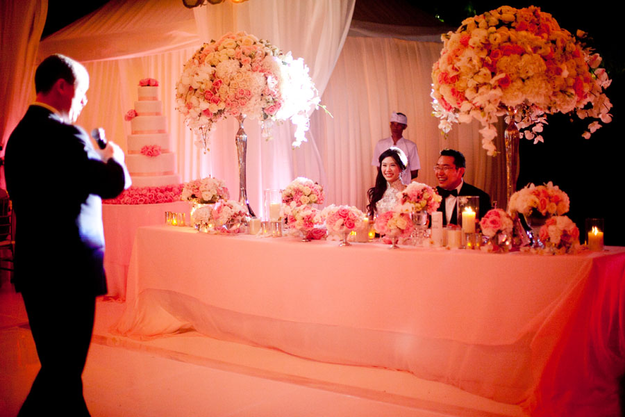 bride's father giving toast at wedding reception to bride and groom at sweetheart table