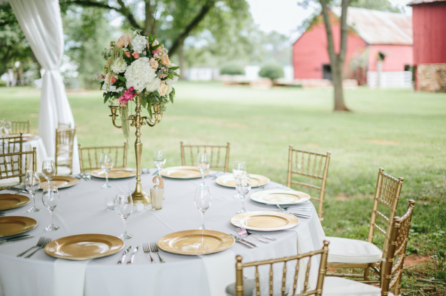 white wedding linens with gold chiffon chairs