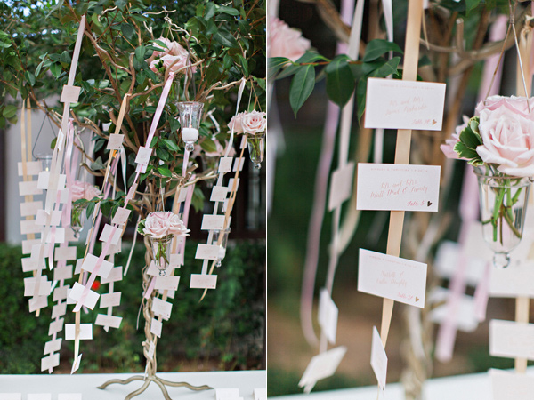 wedding escort cards hanging on ribbon
