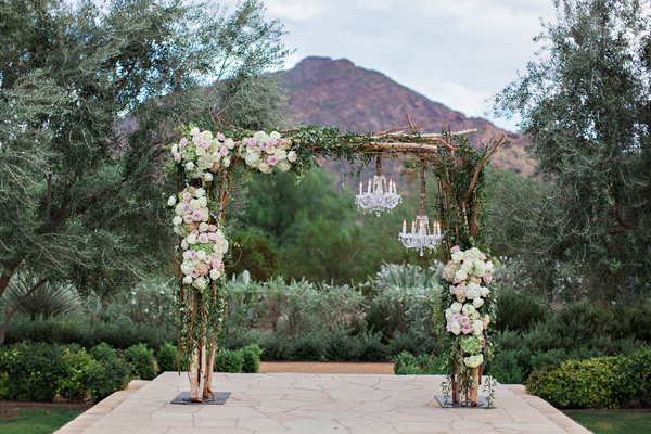 twigs arbor with hydrangeas and roses