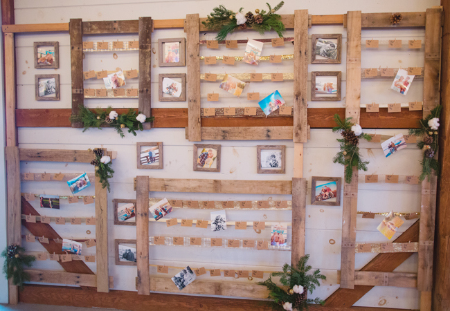 rustic photo wall of the bride and grooms families