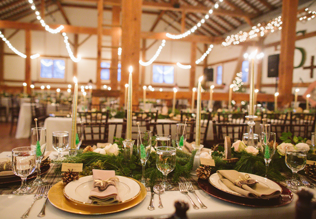 Evergreen decorated wedding kings tables and rock candy drink stirs at wedding reception