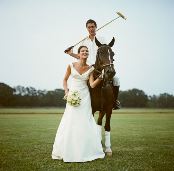 bride in monique lhuillier and groom on horse with polo stick