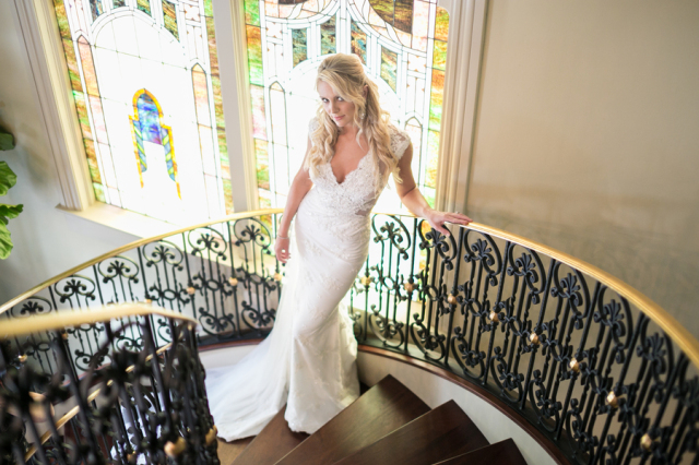 bride posing on spiral staircase
