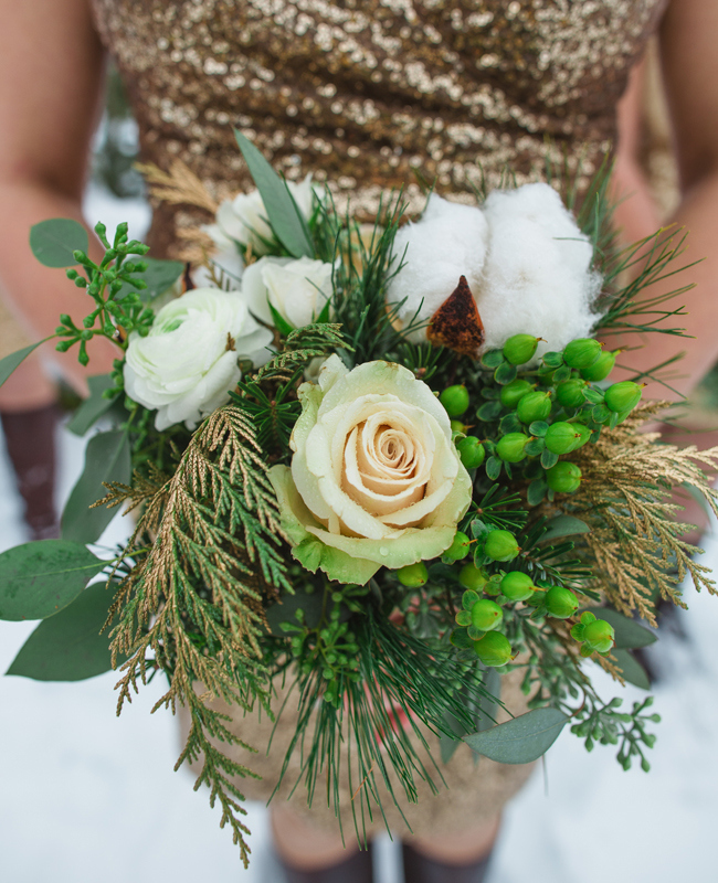 rustic bridesmaid bouquet with roses and evergreen