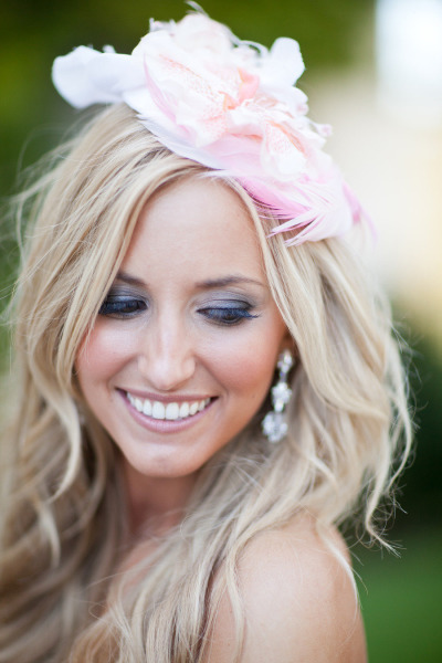 bride with pretty makeup and pink flower hair piece