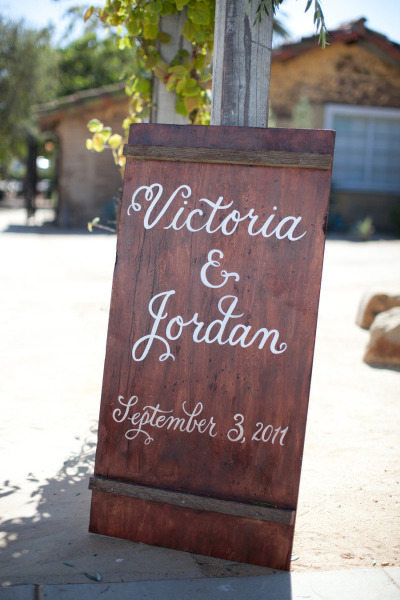sign with the bride and grooms name and their wedding date