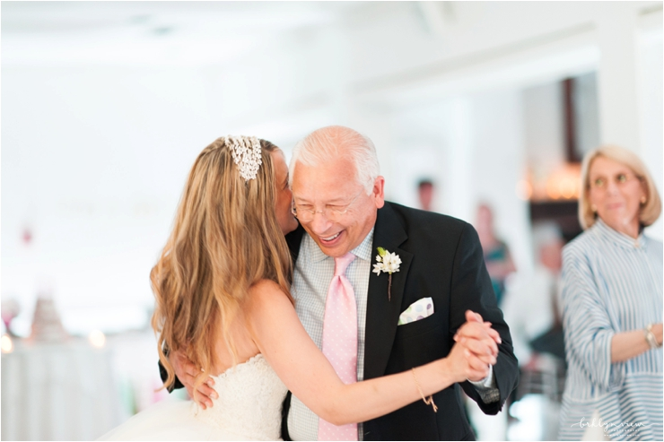 father daughter dance and father smiling and bride wearing head piece