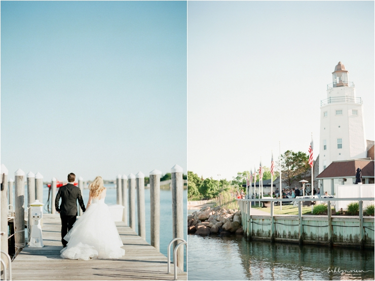 bride and groom running down dock and light house
