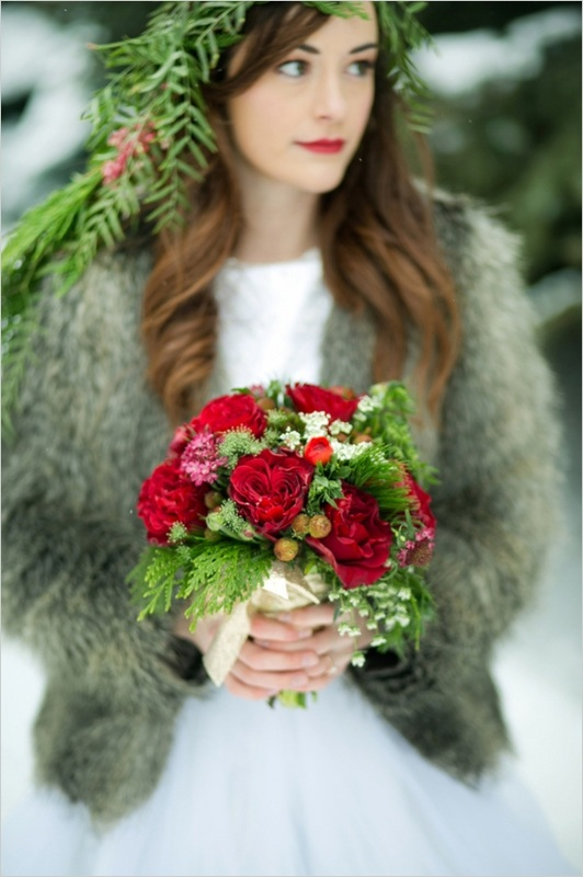bride in the snow with red flowers and evergreen crown, bride in fur