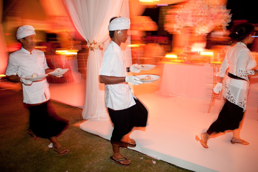 waiters serving food at wedding reception