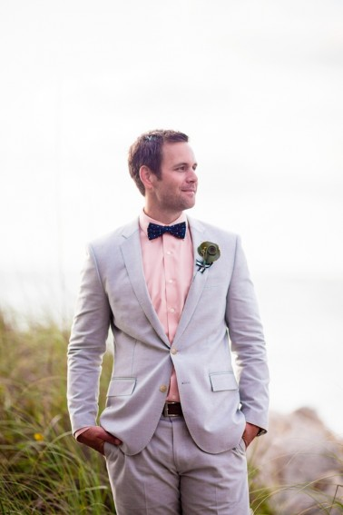 groom in grey tux and bow tie