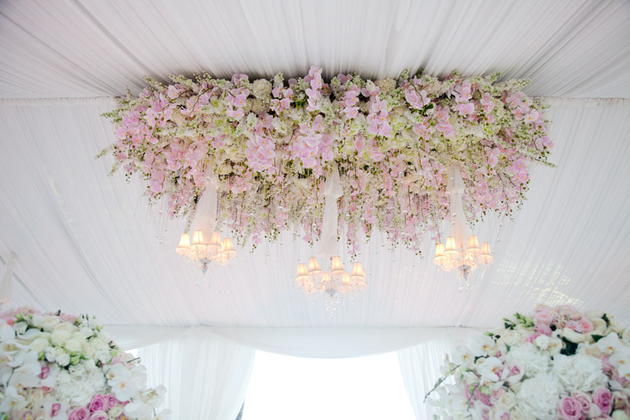 wedding flowers at the top of marquee tent