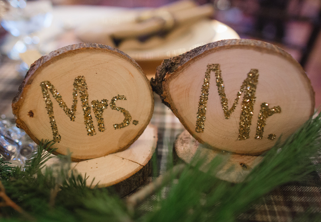 Mr. and Mrs. in gold letters on tree stumps