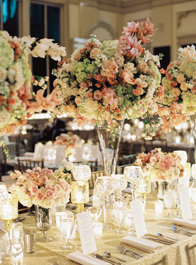 elaborate wedding high and low flower centerpieces with white, pink, coral ad green flowers