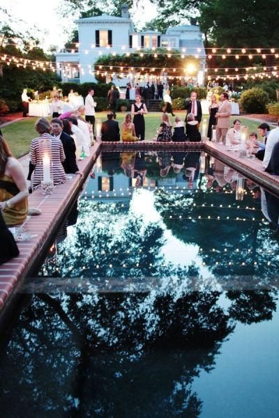 sophisticated backyard wedding by the pool with edison lights