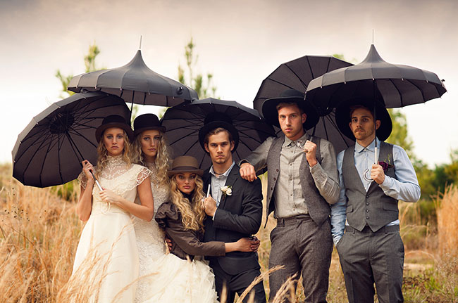 vintage styled wedding shoot with bridal party in vintage attire holding parasols