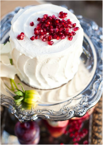one layer white cake with pomegranates on top