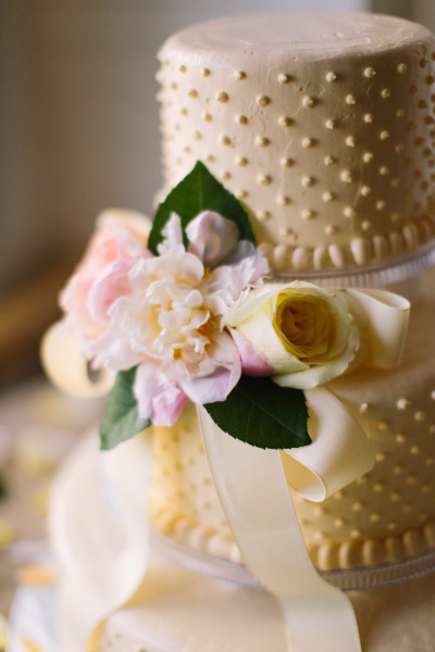 white cake buttons and flowers
