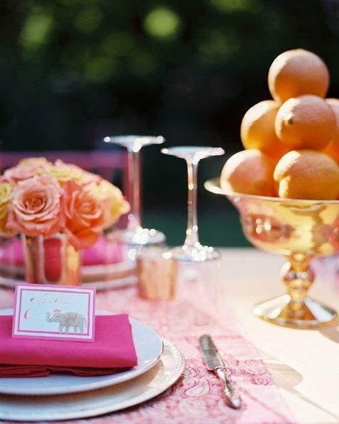 pink wedding reception table with oranges