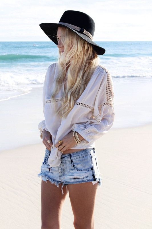 black floppy hat with jean shorts