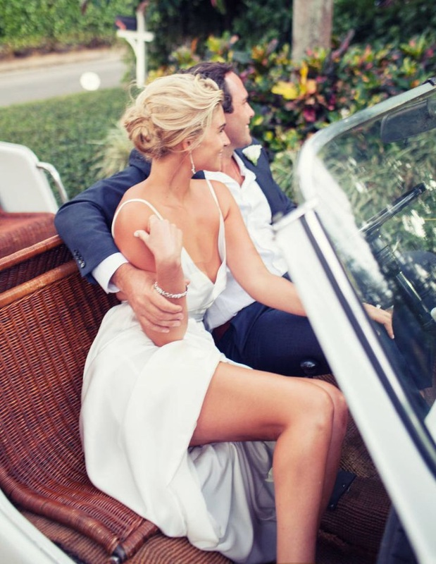 sophisticated bride and groom in vintage car